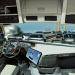 Self driving truck with head up display on a road. Inside view.